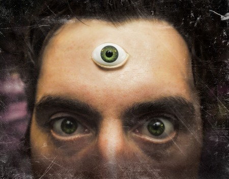 third eye: Handsome male fortune teller with magic third eye Stock Photo
