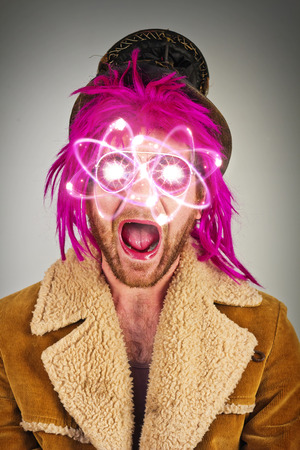 Pink haired bearded lunatic with atomic particle sunglasses