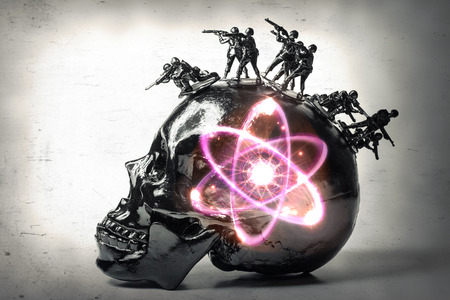 atomic bomb: Black skull with toy soldiers forming war mohawk with radioactive atomic particle