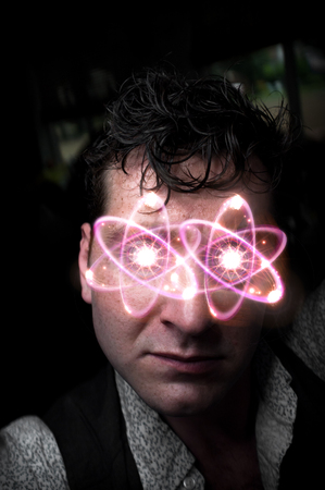 neutrons: Dramatic portrait of concerned pensive man with atomic eyes