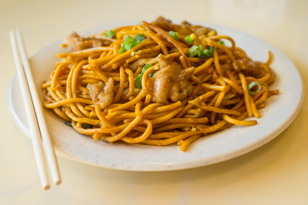 lo mein: Chinese food tasty chicken lo mein noodles at restaurant Stock Photo