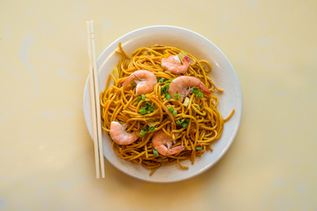 Chinese food tasty shrimp lo mein noodles at restaurant Stock Photo