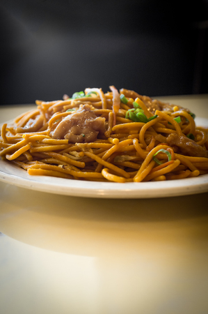 Chinese food tasty chicken lo mein noodles at restaurant Stock Photo