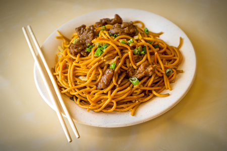 Chinese food tasty beef lo mein noodles at restaurant