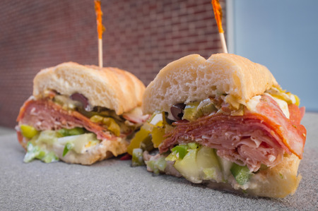 The works Italian sub sandwich with fancy toothpicks Stock Photo