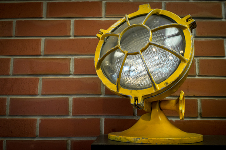 antique fire truck: Vintage police or firefighter emergency light closeup with brick wall