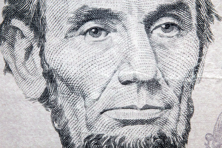 Macro closeup Abraham Lincoln on five dollar bill Stock Photo