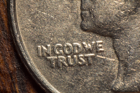 in god we trust: Macro closeup In God we trust worn quarter