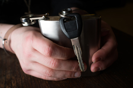 dwi: Girls hands hold alcohol flask and keys while handcuffed
