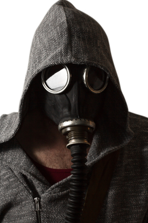 Scary man wearing authentic Russian gas mask with breathing hose