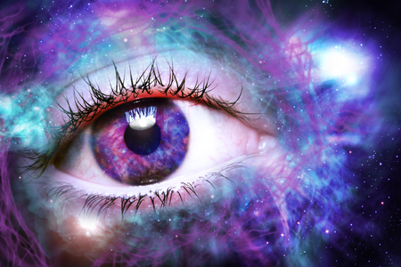 Giant eyeball starscape backdrop with colorful space clouds Stock Photo