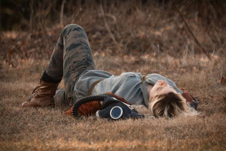 gasmask: Pretty girl resting in field with authentic Russian gas mask