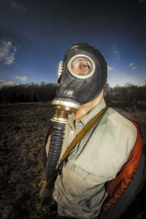 Scary girl wearing authentic Russian gas mask with breathing hose Stock Photo
