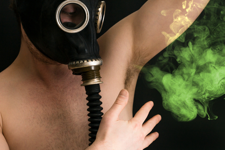 gasmask: Gasmask protects from smelly armpit body odor wafting into the air Stock Photo