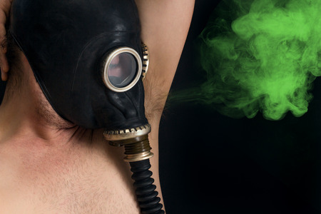 Gasmask protects from smelly armpit body odor wafting into the air Stock Photo