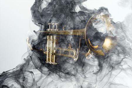 Abstract smoke billows around jazz brass trumpet