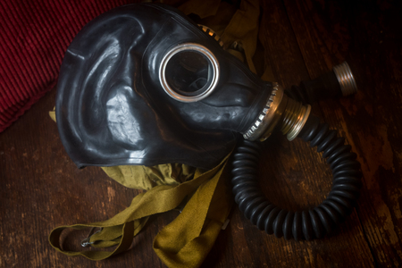 Authentic Soviet gasmask on rustic worn wooden table