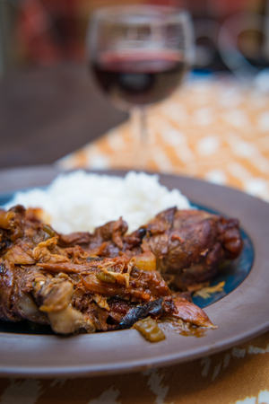 Slow cooked French Coq Au Vin with fluffy white rice