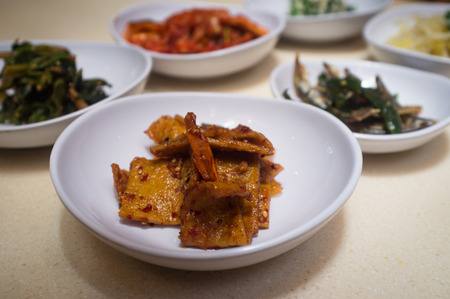 Closeup authentic Korean banchan dinner sides in bowls