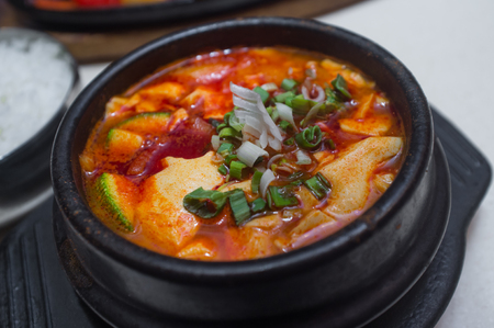 Sundubu jjigae Korean spicy soft tofu soup with zucchini Фото со стока