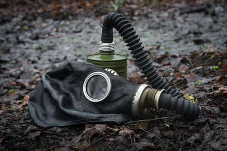 gasmask: Scary authentic Russian gas mask with breathing hose abandoned in woods