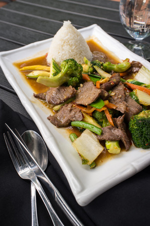 Thai beef pad pak with rice and mixed vegetables Stock Photo