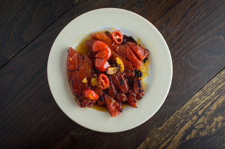 Grilled watermelon with fresh roasted garlic and grape tomatoes Stock Photo