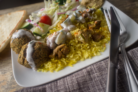 NYC street style Halal chicken and yellow rice with falafel and pita bread