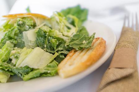 Fresh organic caesar salad with fried parmesan