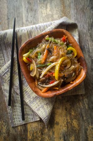 Korean Japchae vegetarian stir fried cellophane noodles with vegetables Reklamní fotografie - 85955915