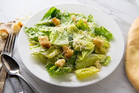 Fresh organic Caesar salad with ciabatta croutons and parmesan cheese