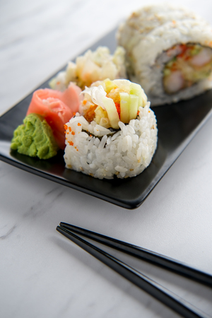 Fresh shrimp tempura sushi roll with wasabi and ginger