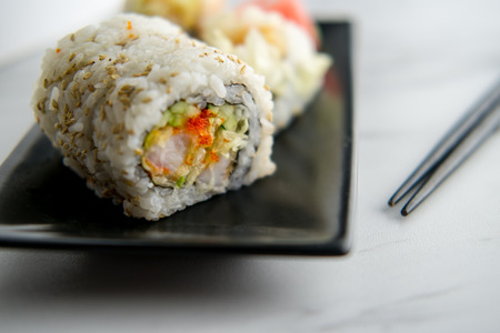 Fresh shrimp tempura sushi roll with wasabi and ginger
