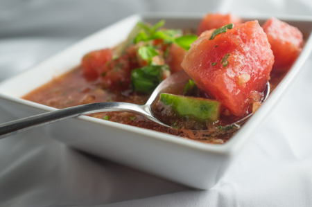 Fresh Spanish cuisine gazpacho served with cucumbers and watermelon
