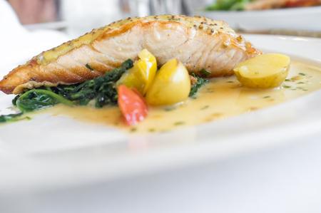 Baked dijon mustard salmon with fingerling potatoes in white wine sauce