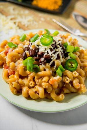 Fancy taco macaroni and cheese with black beans jalapenos and white cheddar