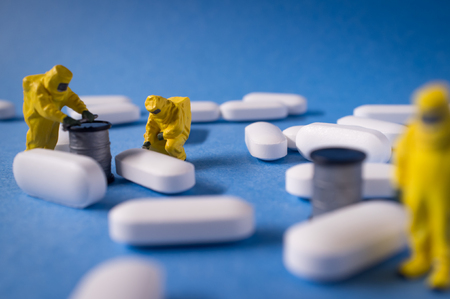 Miniature hazmat team inspects hazardous pain killer pills