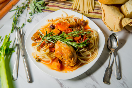 Italian chicken Cacciatore hunter's stew with spaghetti noodles and crusty bread Stok Fotoğraf