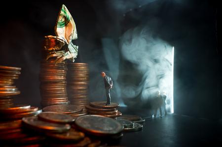 Businessmen meet with origami dollar spider in evil money concept