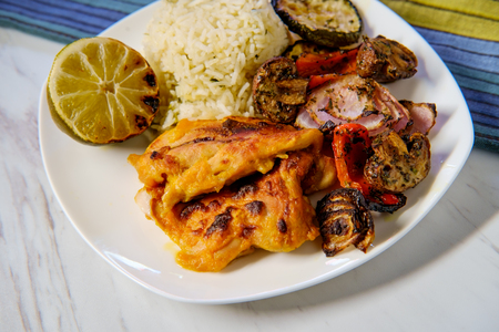Mango marinated chicken thighs with grilled vegetables