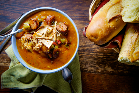 Spicy New Orleans chicken and andouille sausage Gumbo with fresh crusty bread Stock Photo