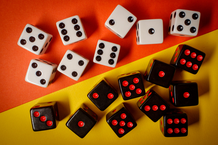 Many game dice on colorful background, gambling theme Foto de archivo