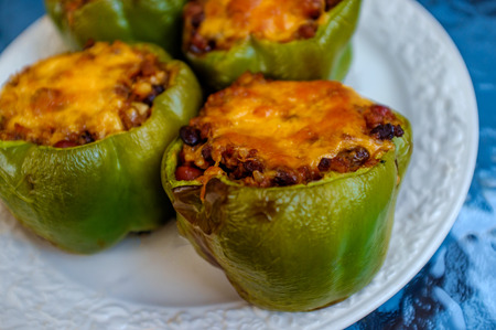 Mexican stuffed green bell pepper cooked on the grill also know as Pimiento Relleno Stock Photo