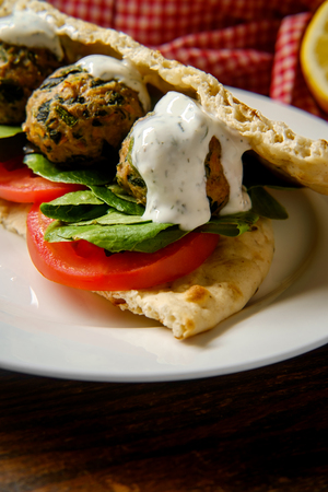 Mediterranean turkey meatball sandwich on pita bread with dill yogurt sauce 版權商用圖片