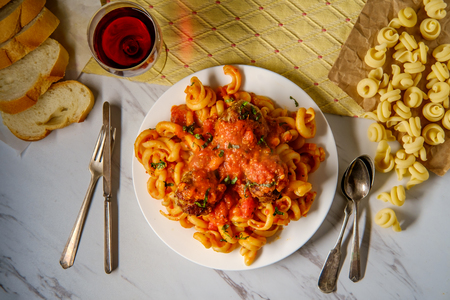 Spaghetti and meatballs with     noodles and chopped fresh basil Reklamní fotografie