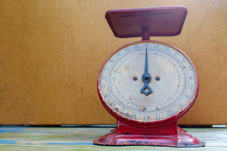Old fashioned red antique weight measuring scale