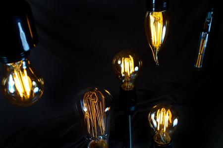 Many hanging decorative antique edison style lightbulbs Stock Photo