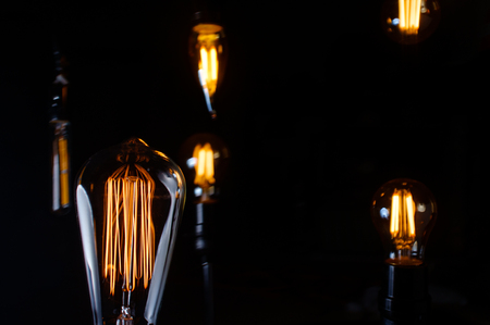 Many hanging decorative antique edison style lightbulbs 写真素材
