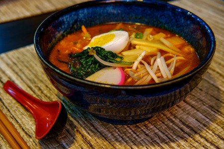 Fresh spicy korean ramen with bean sprouts hard boiled egg and spinach Stock Photo