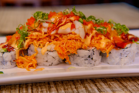 Beautiful spicy special Volcano sushi roll with crab meat and spicy mayonnaise